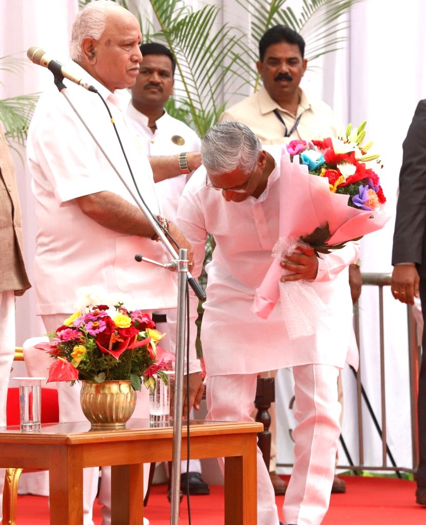 Newly inducted Karnataka Cabinet Minister Shrimant Balasaheb Patil seeks the blessings of Chief Minister B.S. Yediyurappa after taking oath, at a swearing-in ceremony held at Raj Bhavan, ... - Shrimant Balasaheb Patil
