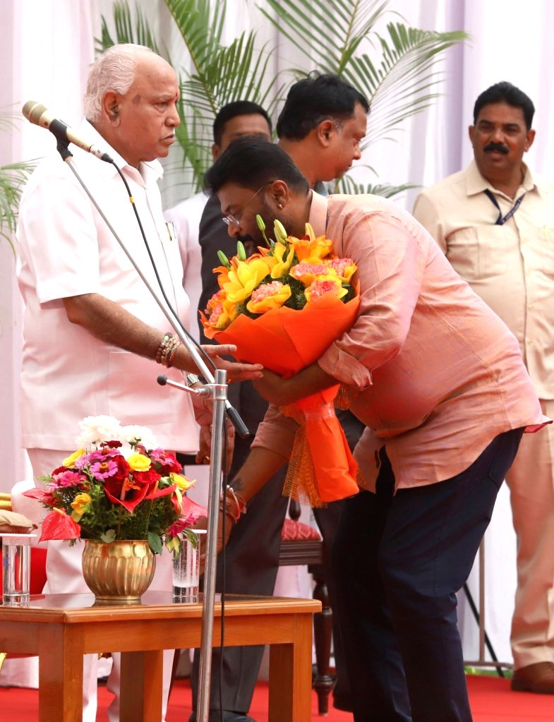 Newly inducted Karnataka Cabinet Minister Anand Singh seeks the blessings of Chief Minister B.S. Yediyurappa after taking oath, at a swearing-in ceremony held at Raj Bhavan, in Bengaluru ... - Anand Singh