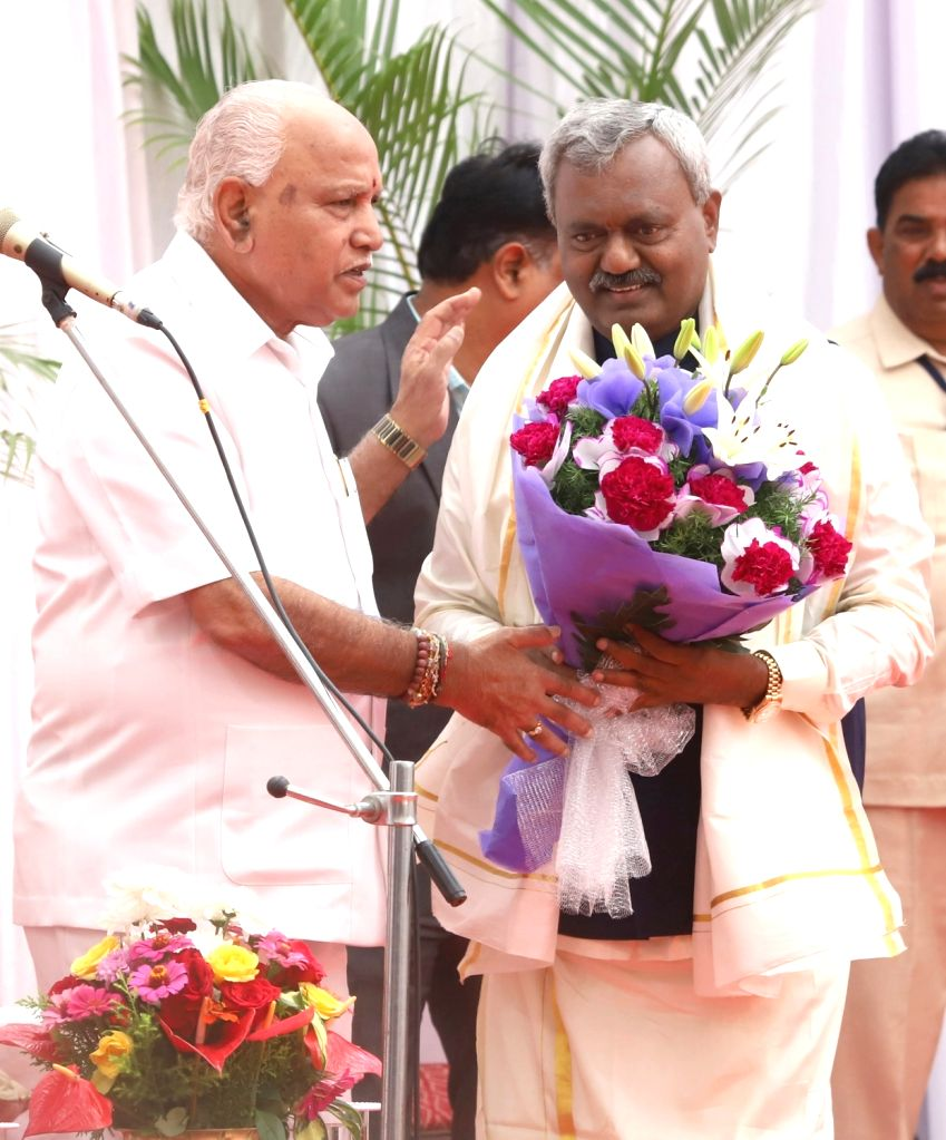 Newly inducted Karnataka Cabinet Minister ST Somashekar seeks the blessings of Chief Minister B.S. Yediyurappa after taking oath, at a swearing-in ceremony held at Raj Bhavan, in Bengaluru ... - S