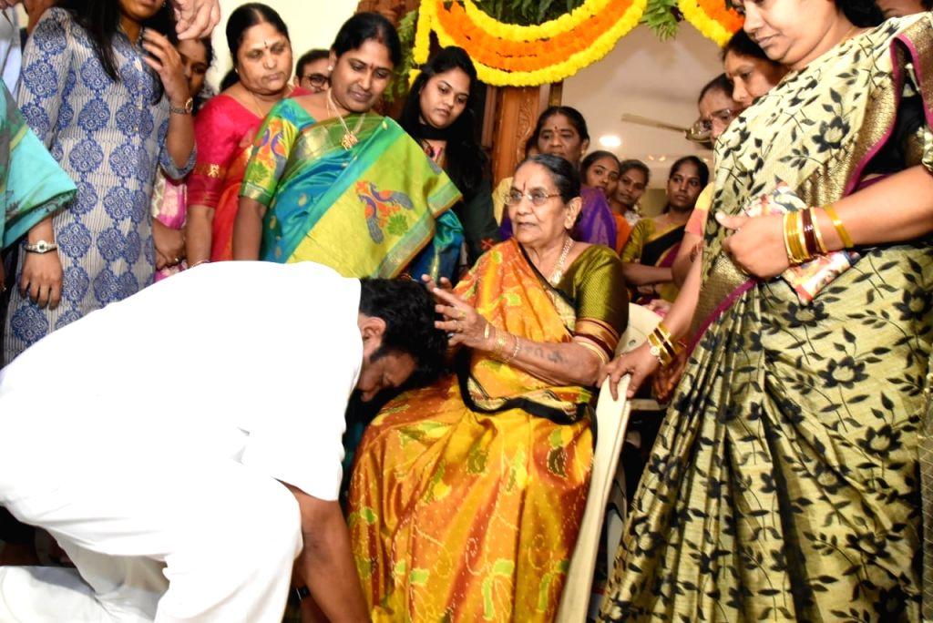 Newly inducted minister T. Srinivas Yadav takes mother's blessing in Hyderabad, on Feb 19, 2019. - T. Srinivas Yadav