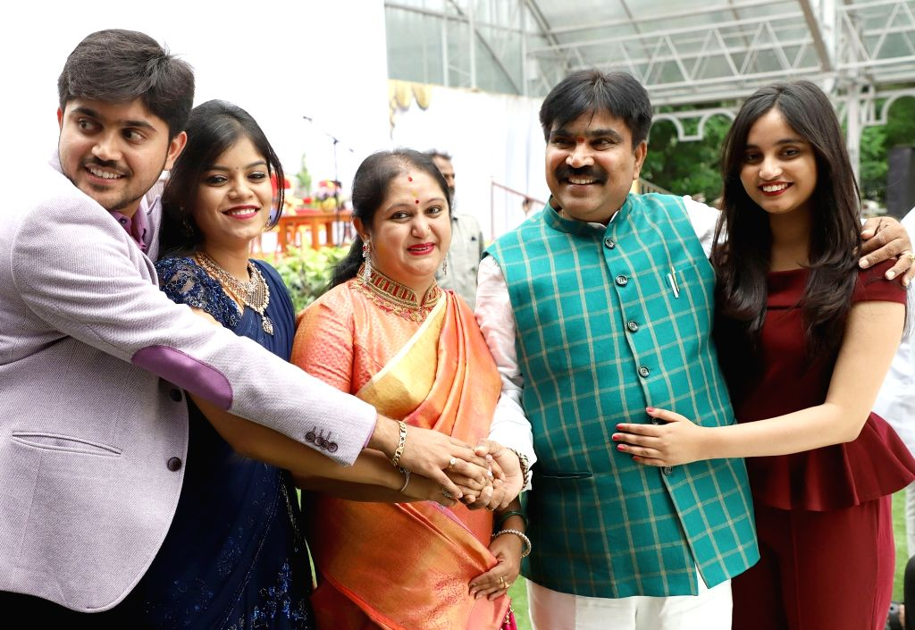 Newly inducted MLA H Nagesh with his family members before the Cabinet expansion of Janata Dal-Secular (JD-S)-Congress coalition government at Raj Bhavan, in Bengaluru, on June 14, 2019.