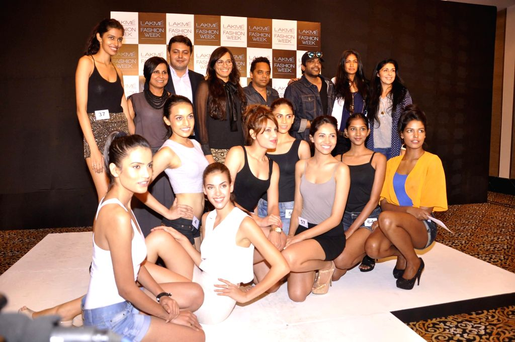 Newly selected models pose with the selection judeges after auditioning for the Lakme Fashion Week, in Mumbai  on July 3, 2014. The LFW Winter/Festive which is scheduled for August 22-24, 2014.