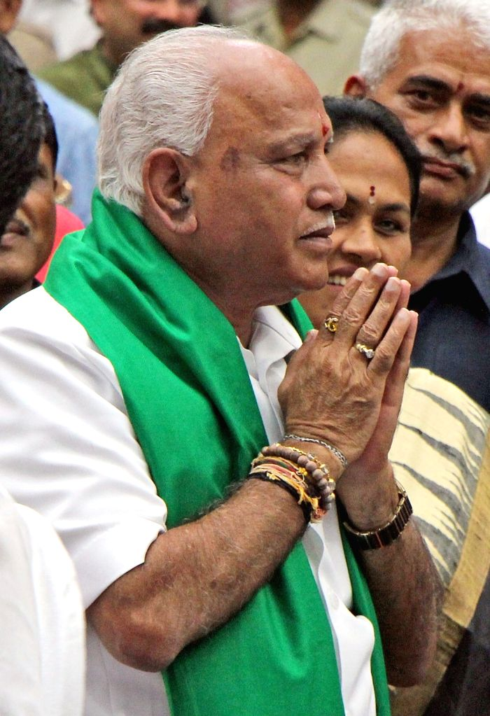 Newly sworn-in Karnataka Chief Minister B. S. Yediyurappa with Former Chief Minister SM Krishna during his wearing-in ceremony at Raj Bhavan in Bengaluru on July 26, 2019. - B. S. Yediyurappa