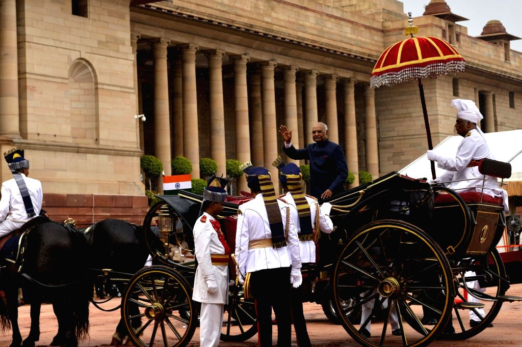 Newly sworn-in President Ram Nath Kovind waves as he leaves in a regal buggy after inspecting the guard of honour in the forecourt of the Rashtrapati Bhavan in New Delhi on July 25, 2017. - Nath Kovind