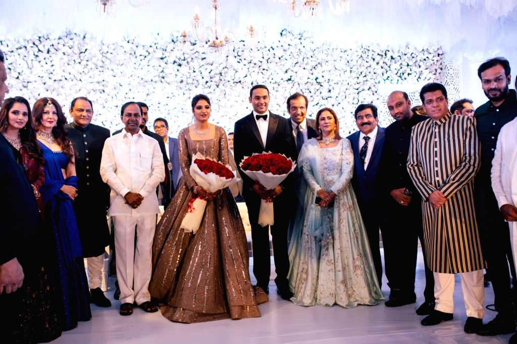 Newly wed couple - Tennis player Sania Mirza's sister Anam Mirza and Former India captain Mohammad Azaharuddin's son Mohammad Asaduddin cut a cake at their wedding reception in Hyderabad ... - Mohammad Azaharuddi, Sania Mirza and Anam Mirza