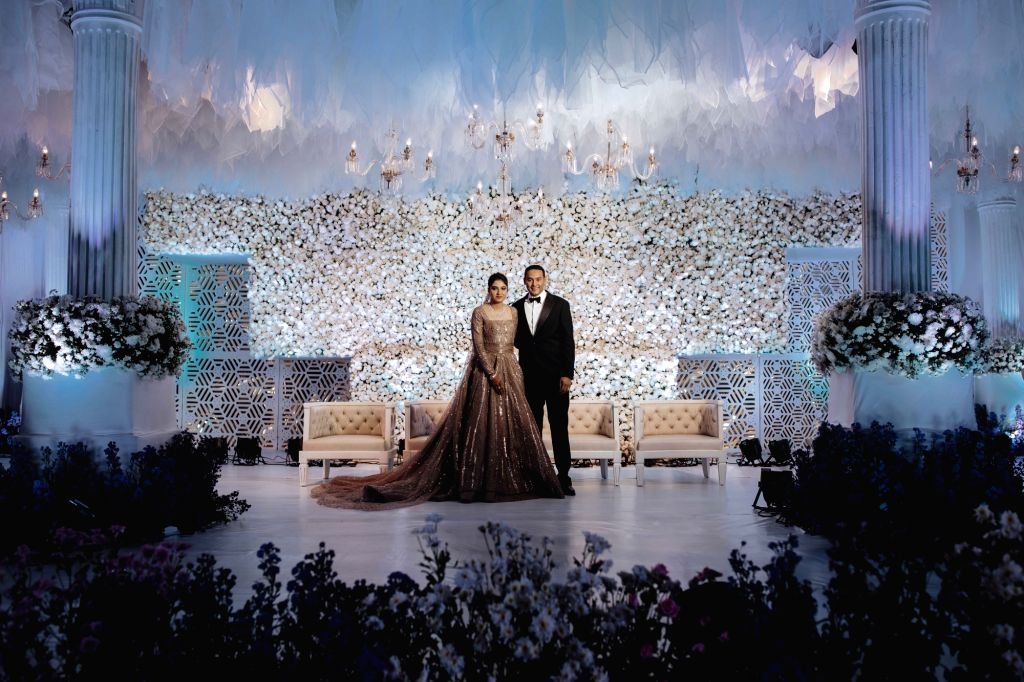 Newly wed couple - Tennis player Sania Mirza's sister Anam Mirza and Former India captain Mohammad Azaharuddin's son Mohammad Asaduddin at their wedding reception in Hyderabad on Dec 12, ... - Mohammad Azaharuddi, Sania Mirza and Anam Mirza