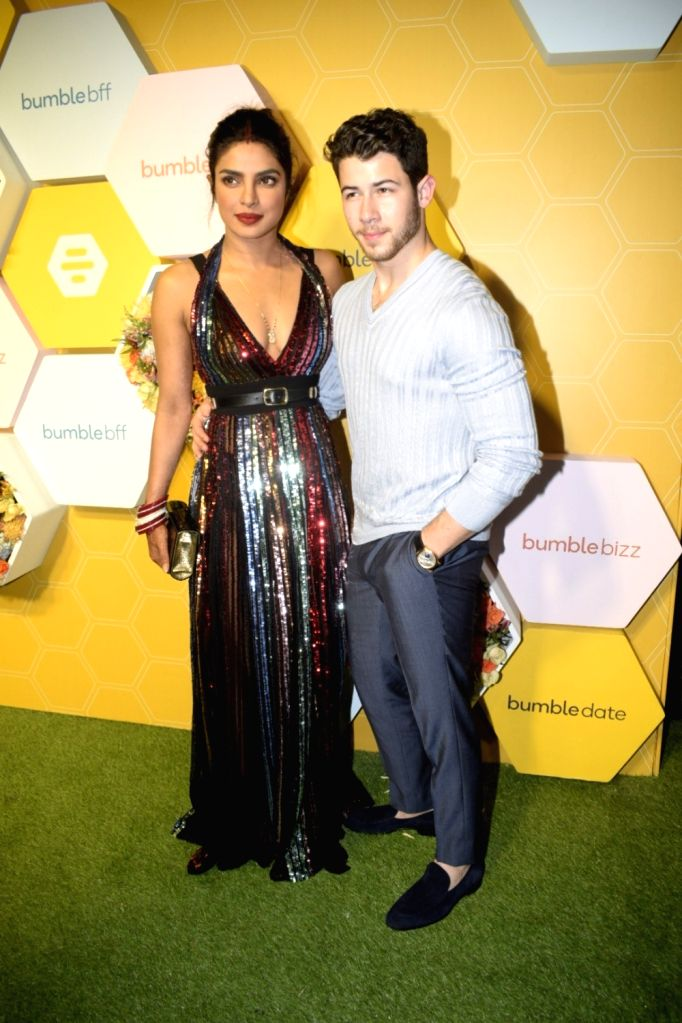 Newlyweds Priyanka Chopra and Nick Jonas during a launch party in Mumbai, on Dec 7, 2018. - Priyanka Chopra