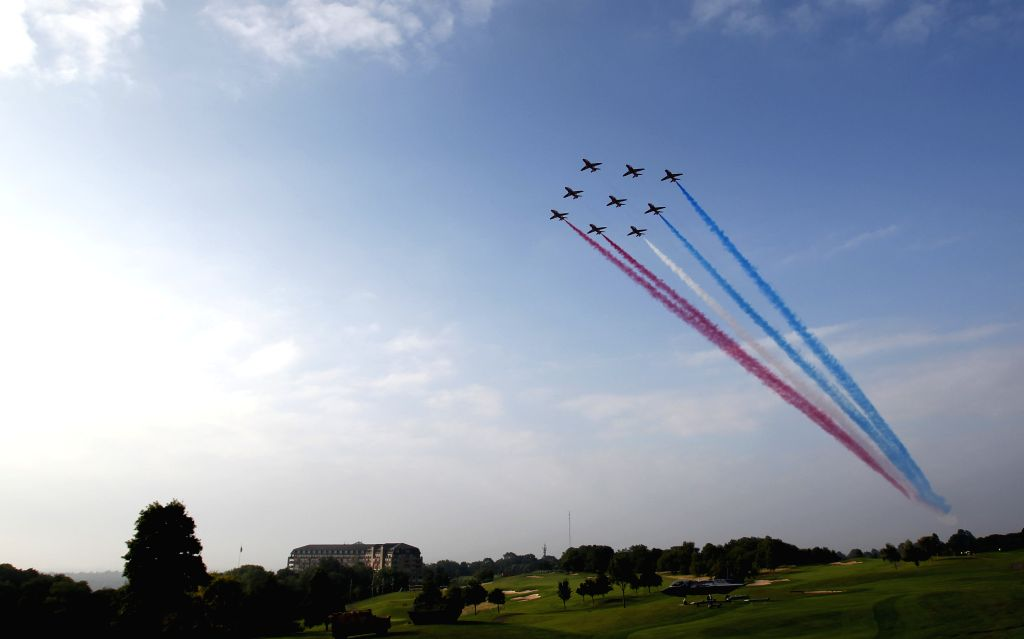 The Red Arrows, the Royal Air Force Aerobatic Team, fly over the Celtic Manor at the NATO Summit 2014 in Newport, Wales, Britain, on September 5, 2014. The North ...