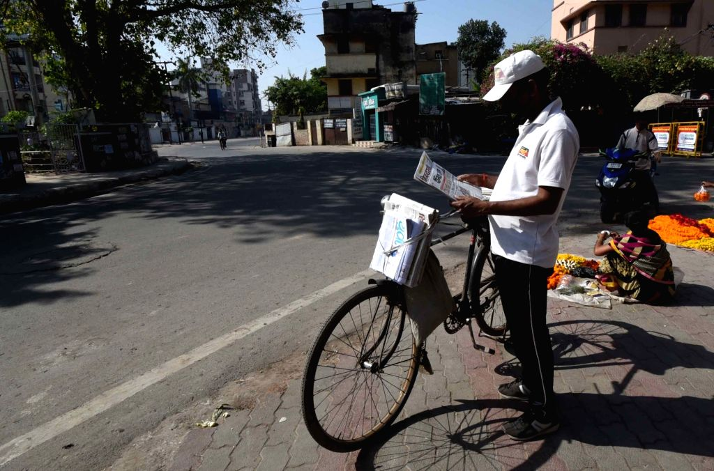 Newspaper vendor in Machhua Toli on Day 2 of the 21-day nationwide lockdown imposed by the Narendra Modi government over the coronavirus pandemic; in Patna on March 26, 2020. - Narendra Modi