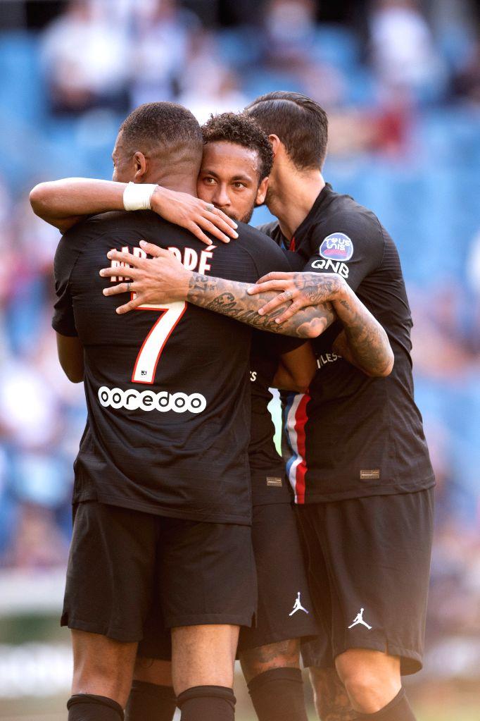 Neymar (C) of Paris Saint Germain celebrates his goal with Kylian Mbappe (L) and Mauro Icardi of Paris Saint Germain during a friendly football match between Paris ...