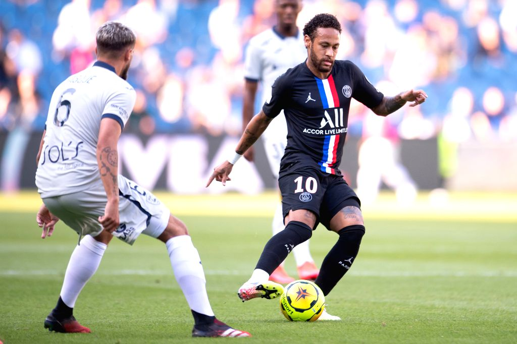 Neymar (R) of Paris Saint Germain in action during a friendly football match between Paris Saint Germain and Le Havre at the Ocean Stadium in Le Havre, France, ...
