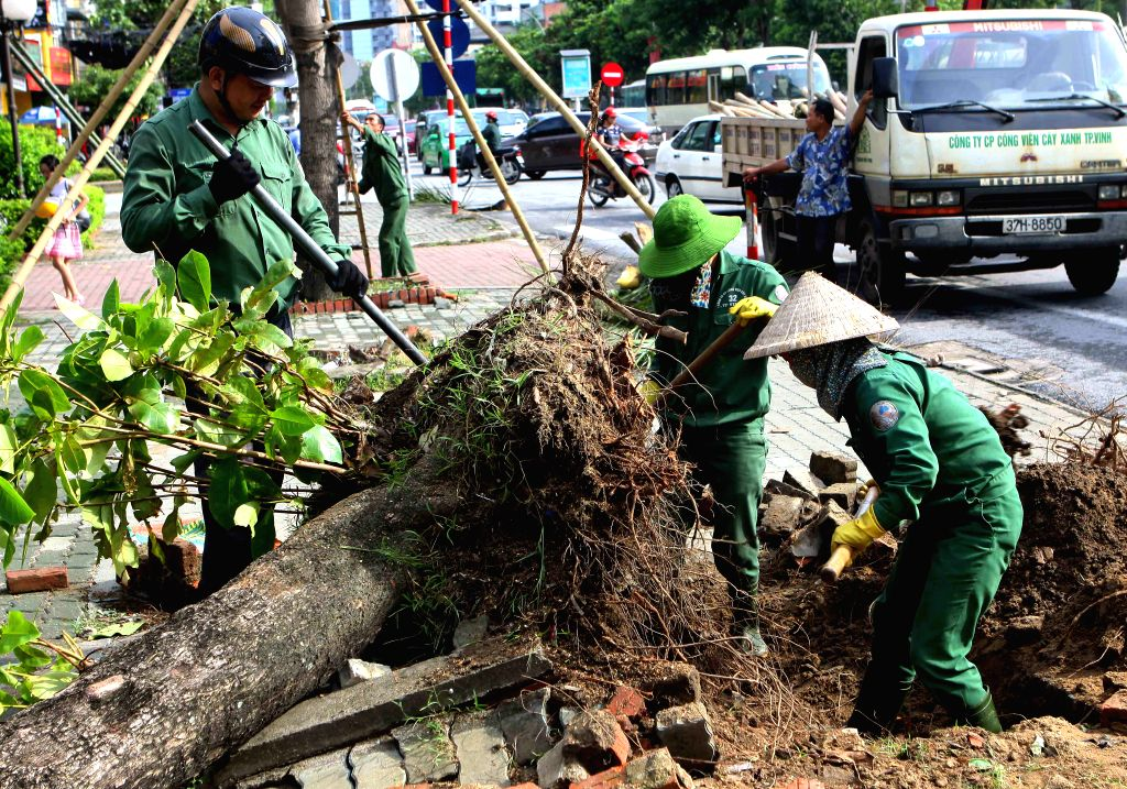 NGHE AN, Sept. 16, 2017 - Local workers clean up the mass after typhoon Doksuri passed in Nghe An province, central Vietnam, Sept. 16, 2017. Typhoon Doksuri has killed 8 people and injured 28 others ...