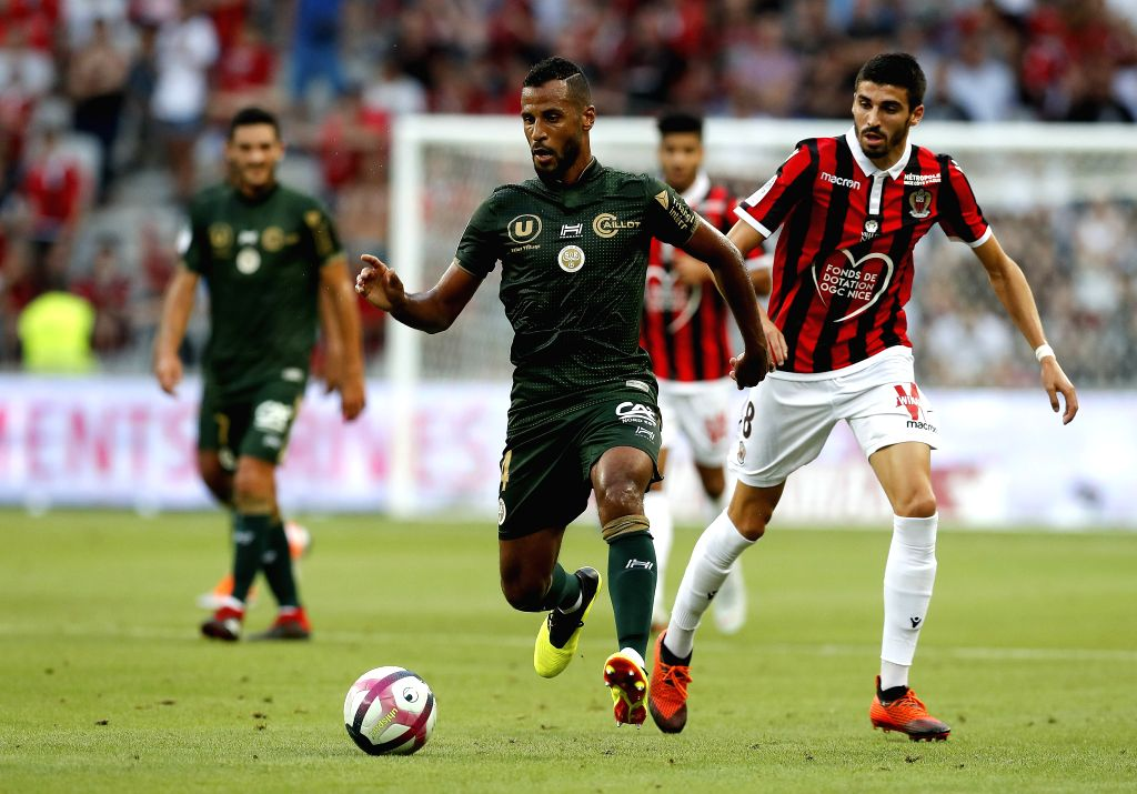 NICE, Aug. 12, 2018 - Alaixys Romao (C) of Reims vies with Pierre Lees-Melou (R) of Rice during the French Ligue 1 football match 2018-19 season 1st round in Nice, France on Aug. 11, 2018. Reims won ...