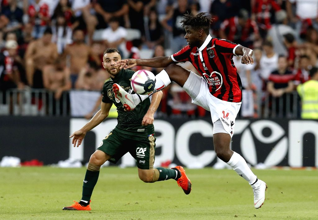 NICE, Aug. 12, 2018 - Allan Saint-Maximin (R) of Nice vies with Marvin Martin of Reims during the French Ligue 1 football match 2018-19 season 1st round in Nice, France on Aug. 11, 2018. Reims won ...