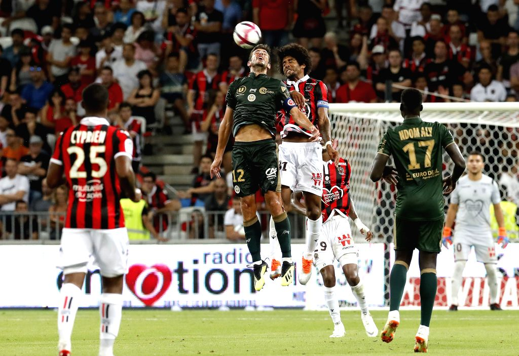 NICE, Aug. 12, 2018 - Dante (top R) of Nice vies with Pablo Chavarria (top L) of Reims during the French Ligue 1 football match 2018-19 season 1st round in Nice, France on Aug. 11, 2018. Reims won ...