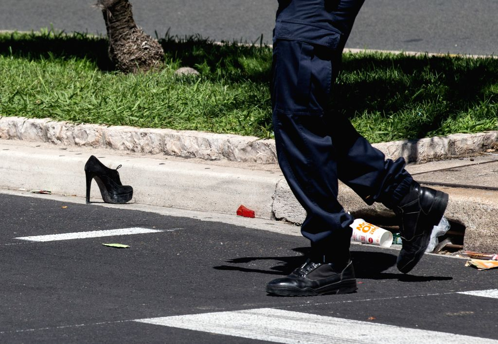 NICE, July 15, 2016 - A victim's shoe is seen at the site of the terrorist attack in Nice, France, July 15, 2016. The death toll rises to 84 from an attack in which a truck rammed into a crowd ...