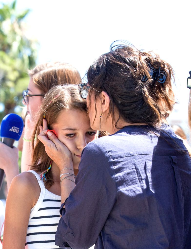 NICE, July 15, 2016 - People comfort each other near the site of the terrorist attack in Nice, France, July 15, 2016. The death toll rises to 84 from an attack in which a truck rammed into a crowd ...
