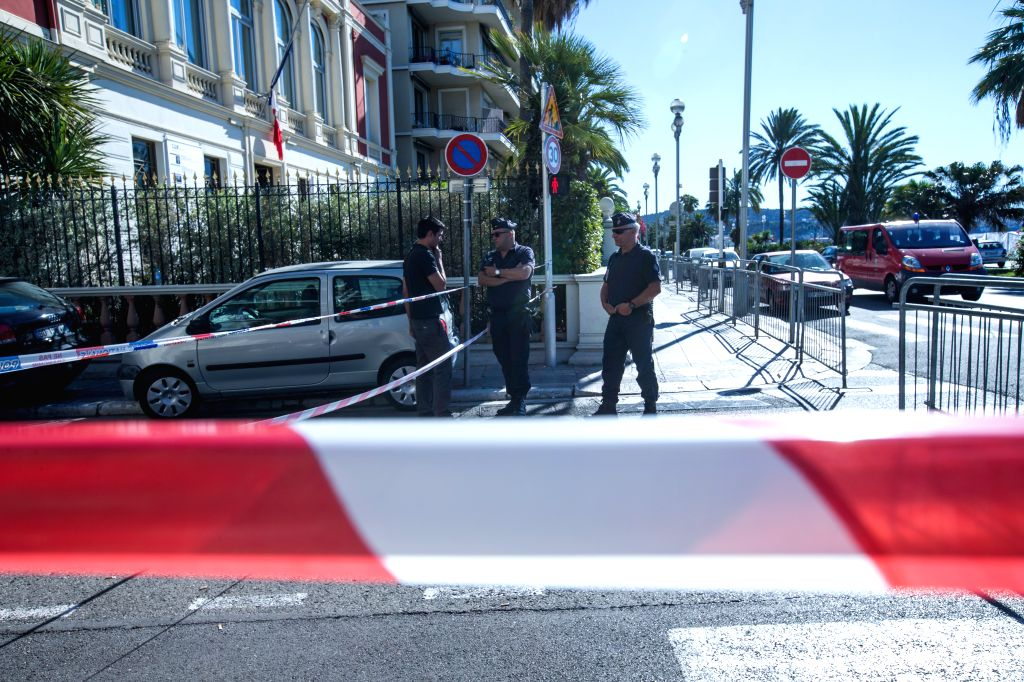NICE, July 15, 2016 - Security personnel stand guard near the Promenade des Anglais, where the attack took place on Thursday, in Nice, France, July 15, 2016. The death toll rises to 84 from an attack ...