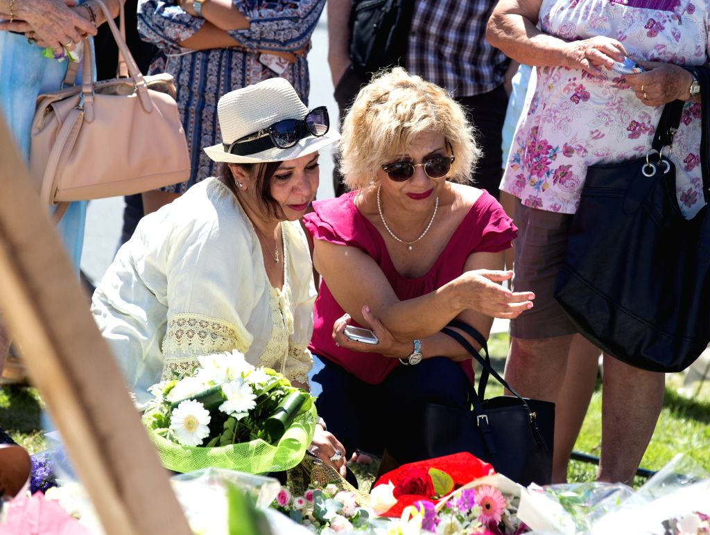 NICE, July 17, 2016 - People gather to mourn the victims on the attack scene at the Promenade des Anglais in Nice, France, July 16, 2016. The Promenade des Anglais in Nice reopened Saturday after a ...