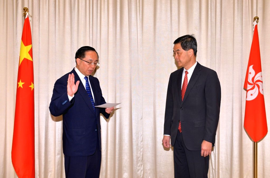 Nicholas W. Yang (L) takes oaths as chief of the newly established Innovation and Technology Bureau (ITB) of the Hong Kong Special Administrative Region (SAR) in ...