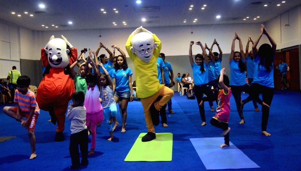 Nickelodeon toons Motu and Patlu teach yoga to children ahead of International Day of Yoga in Mumbai, on June 19, 2016.