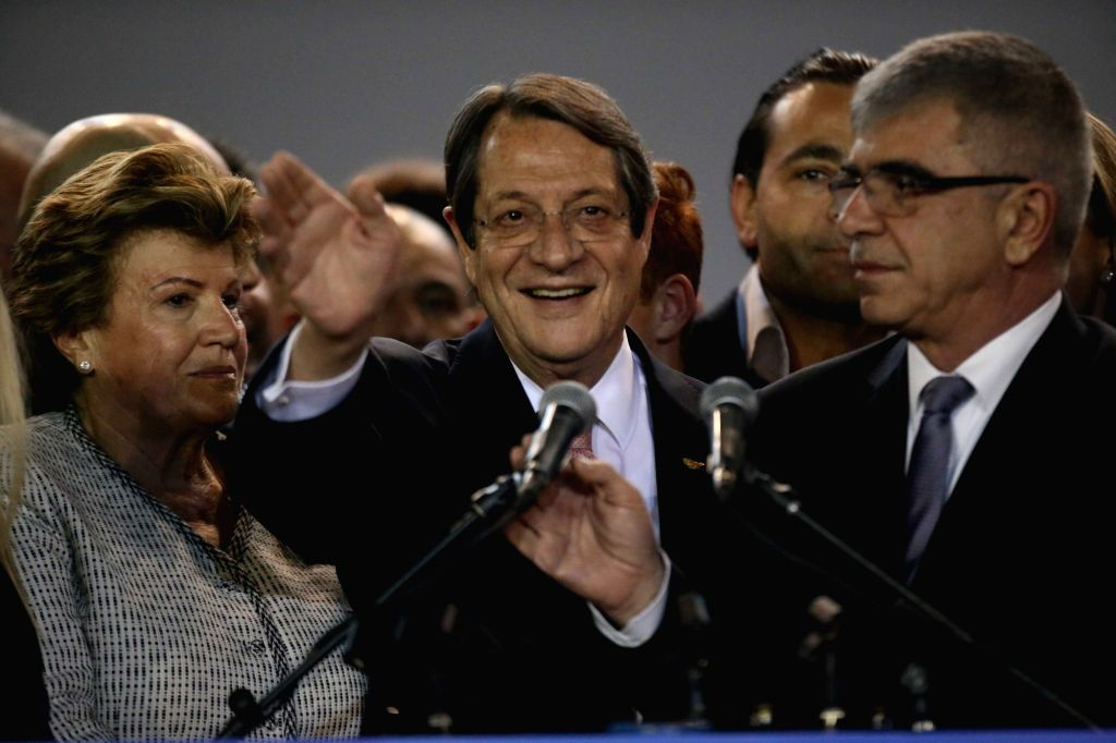 NICOSIA, Feb. 4, 2018 - Cypriot incumbent President Nicos Anastasiades (C) waves to supporters after being re-elected in Nicosia, Cyprus, on Feb. 4, 2018. Nicos Anastasiades comfortably won a second ...