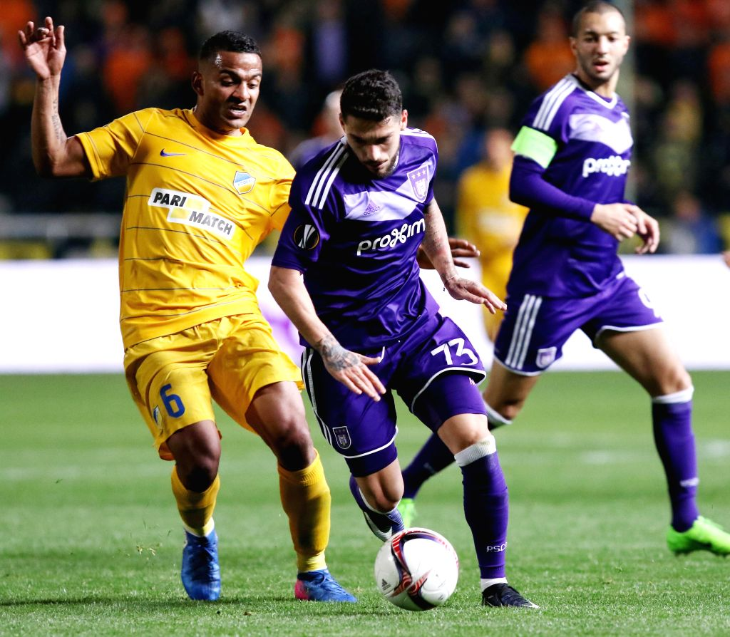 NICOSIA, March 10, 2017 - APOEL's Lorenzo Ebecilio(L) vies with Anderlecht's Nicolae Stanciu during the Europa League Round of 16 first leg match between Anderlecht and APOEL in Nicosia, Cyprus, on ...