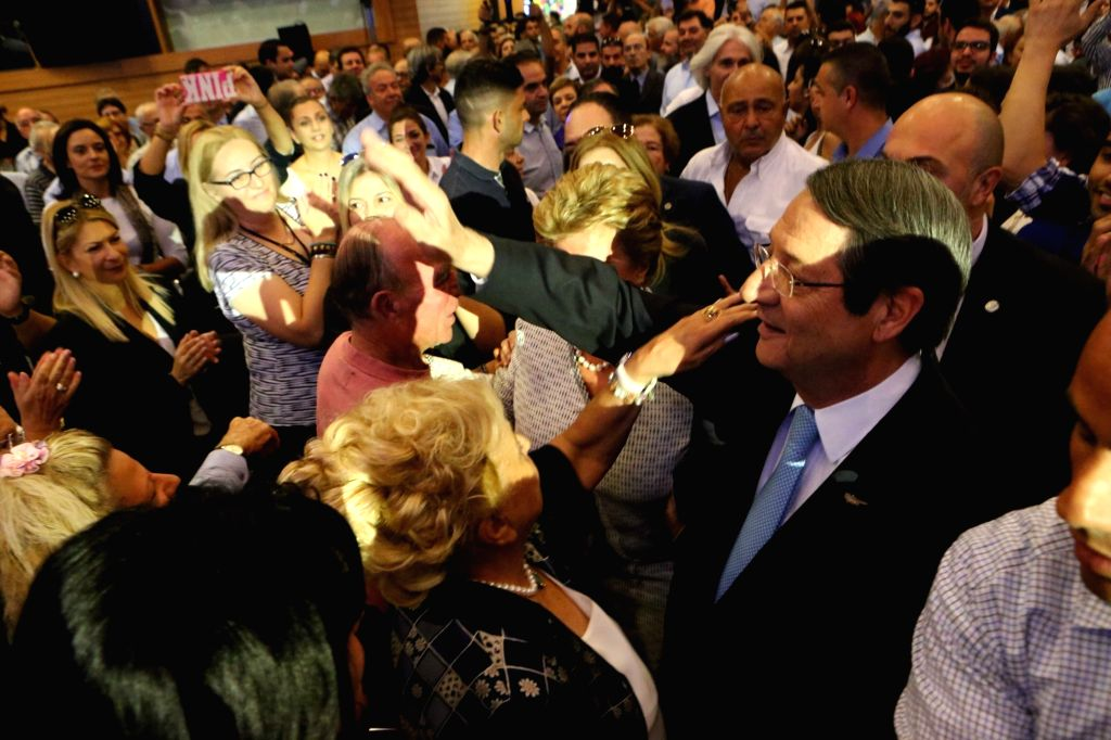 NICOSIA, Oct. 14, 2017 - Cypriot President Nicos Anastasiades (1st R) attends a gathering of ruling DISY party in Nicosia, Cyprus, Oct. 14, 2017. Cyprus' outgoing president Nicos Anastasiades said on ...