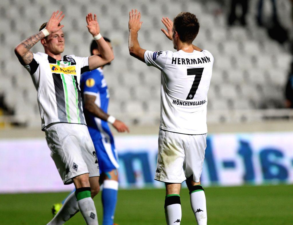 Patrick Herrmann (R) of Monchengladbach celebrates scoring during the UEFA Europa League soccer match against Apollon at GSP Stadium in?Nicosia, Cyprus, Nov. 6, 2014. Monchengladbach won ...