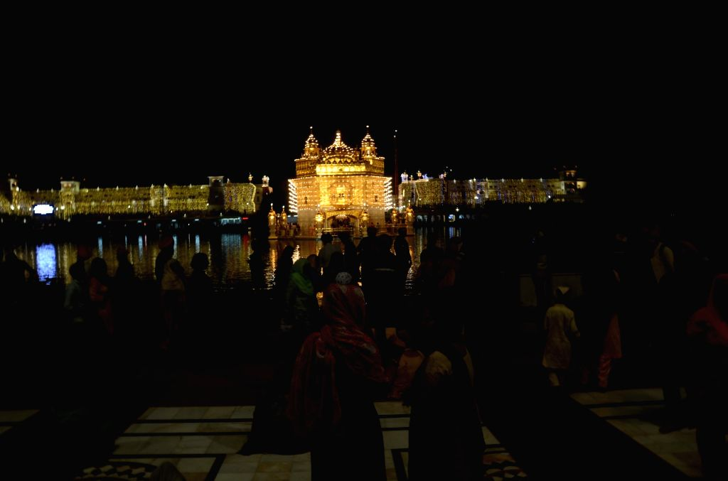 Night view of the beautifully illuminated Golden Temple ahead of the 486th birth anniversary of the fourth Sikh Guru, Guru Ram Das, at the Golden Temple in Amritsar on Oct 31, 2020.
