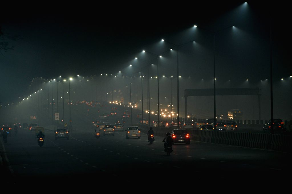 Night view of the National Highway 9 engulfed in a blanket of smog, in New Delhi.