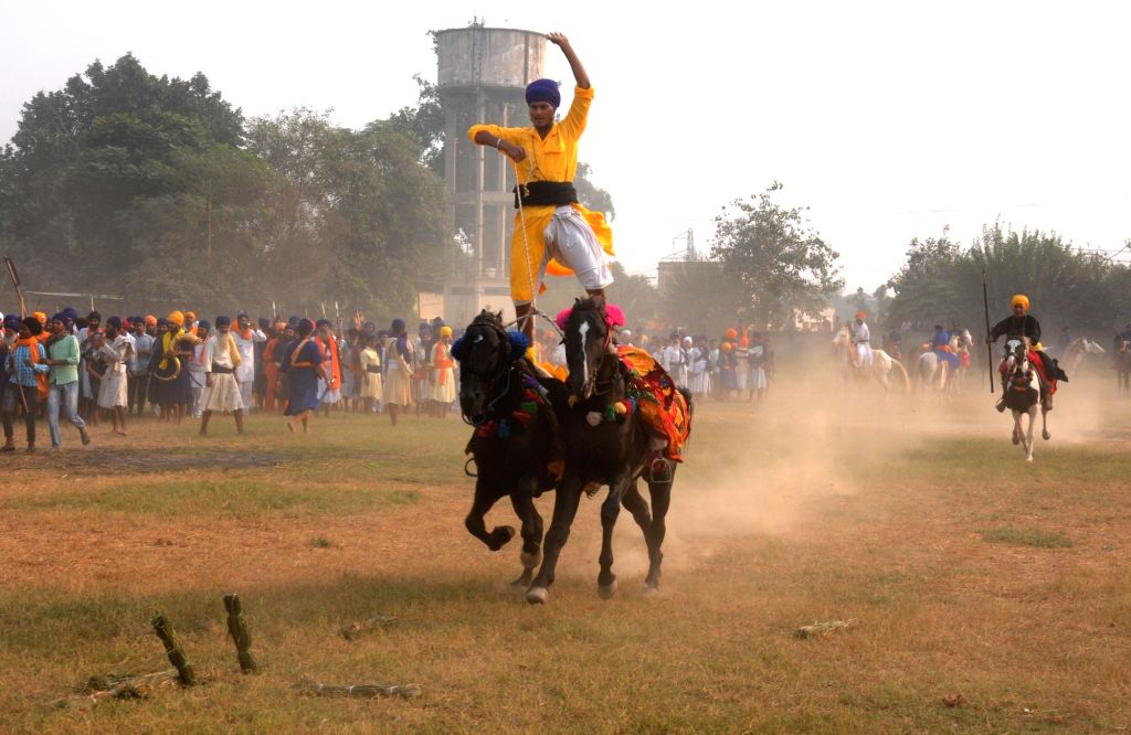 Nihang display their skills during Fateh Divas celebration in Amritsar on Oct 31, 2016.