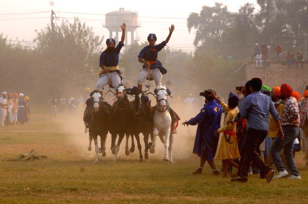 Nihang display their skills during Fateh Divas celebration in Amritsar on Oct 31, 2016.