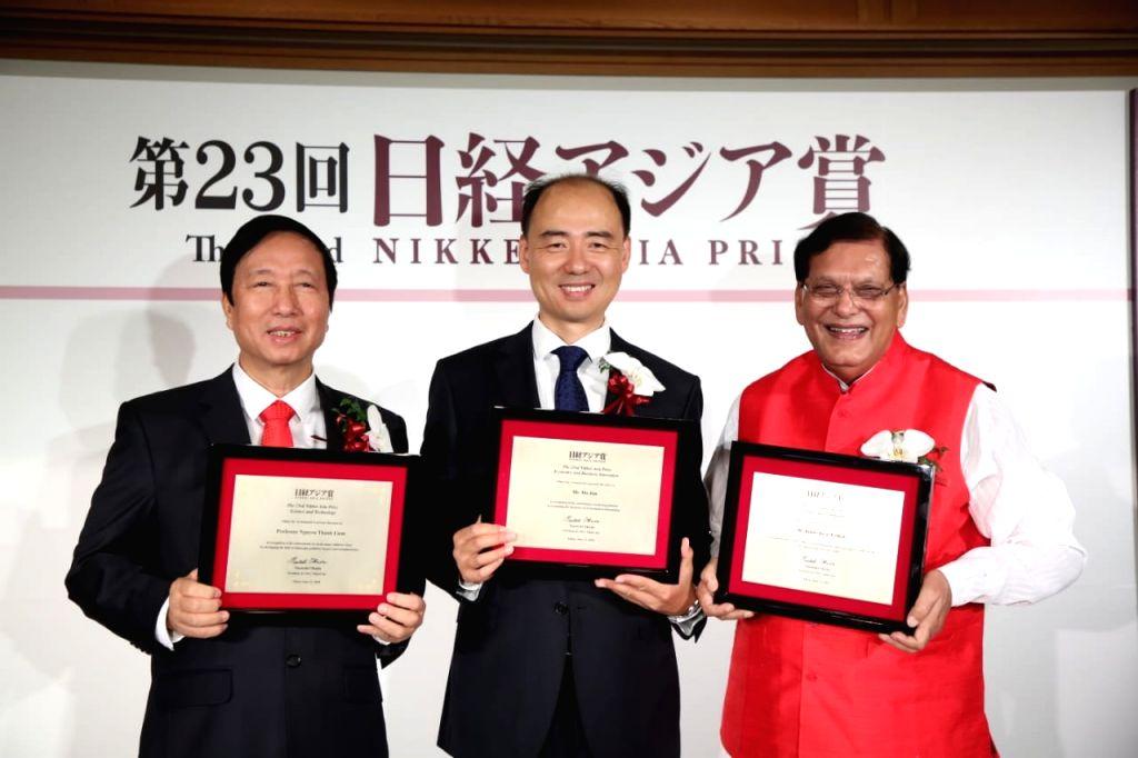 Nikkei Asia Prize recipients Chinese environmentalist Ma Jun, Vietnamese doctor Professor Nguyen Thanh Liem and Sulabh International founder Bindeshwar Pathak at an award ceremony, in Tokyo on ... - Bindeshwar Pathak