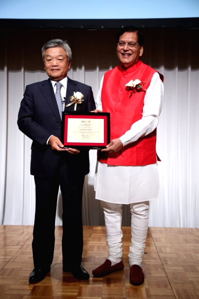 Nikkei Inc President Naotoshi Okada confers Nikkei Asia Prize on Sulabh International founder Bindeshwar Pathak at an award ceremony, in Tokyo on June 13, 2018. - Bindeshwar Pathak