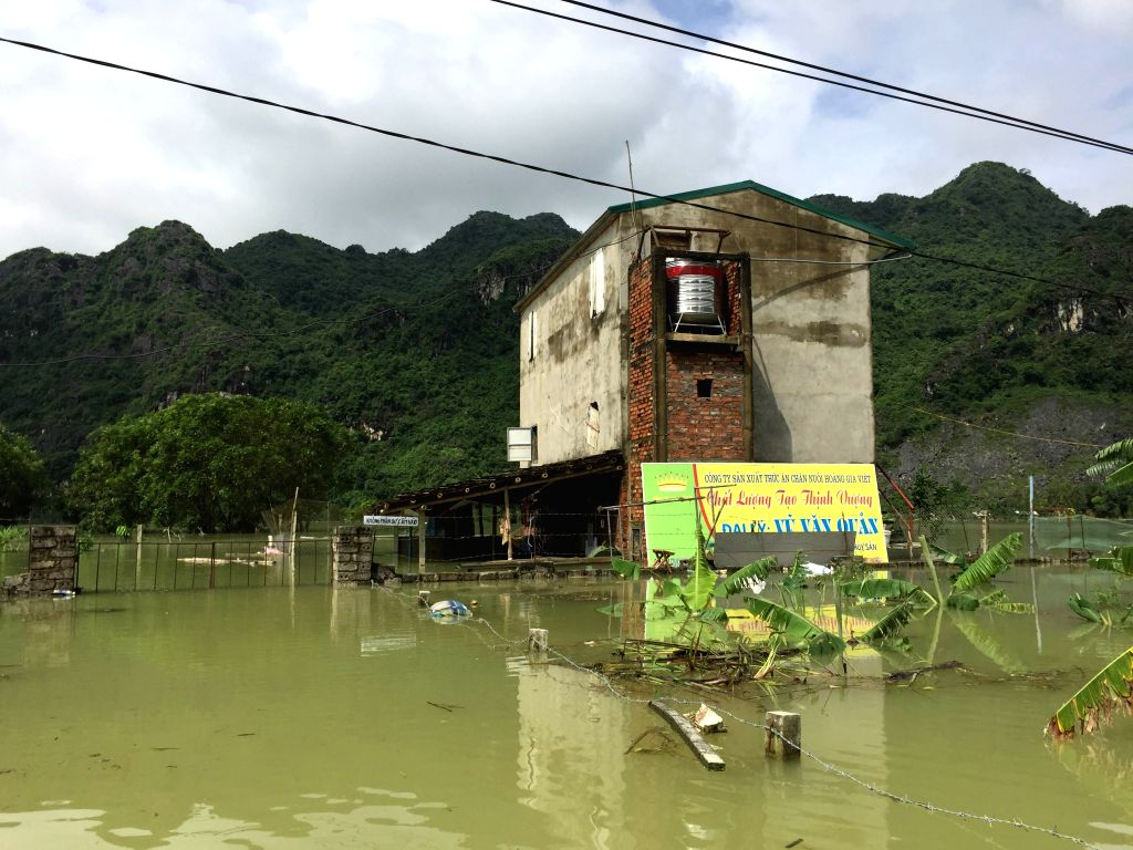 NINH BINH (VIETNAM), Oct. 12, 2017 Photo taken on Oct. 12, 2017 shows a flooded house in Ninh Binh province, northern Vietnam. Landslides and floods triggered by heavy rain over the past ...