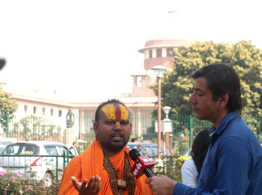 Nirmohi Akhada Mahant Sitaram Das talks to media persons at Supreme Court in New Delhi on March 7, 2019. The Supreme Court on Friday ordered mediation to settle the Ram Janmabhoomi-Babri ...