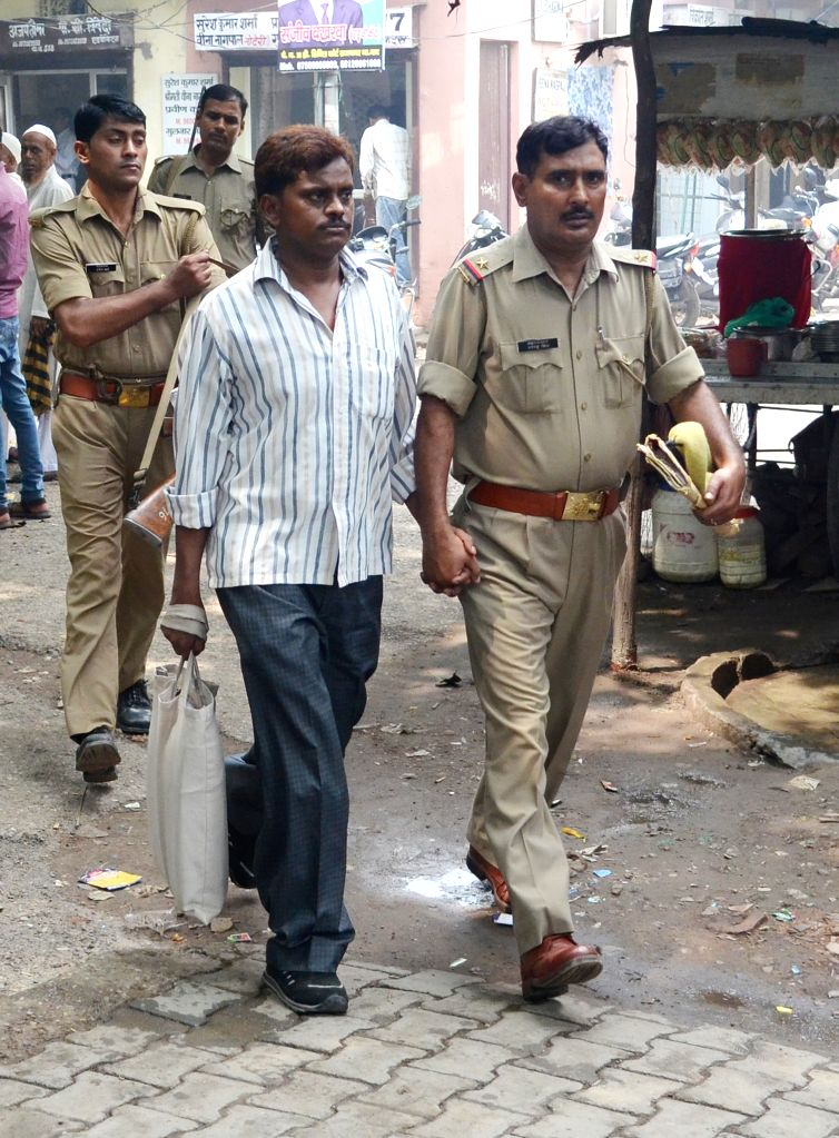 Nithari killings' convict Surender Koli being taken to be produced before a CBI court in Ghaziabad on Aug 14, 2015.