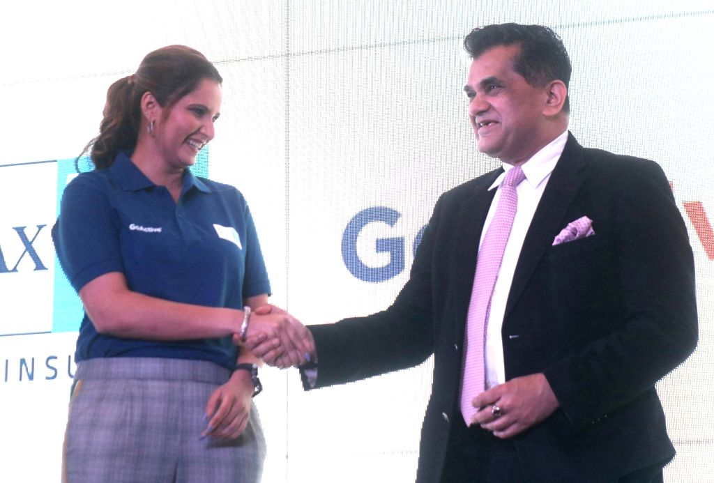 NITI Aayog CEO Amitabh Kant and tennis player Sania Mirza during the launch of a health insurance plan in New Delhi on Feb 13, 2018. - Sania Mirza