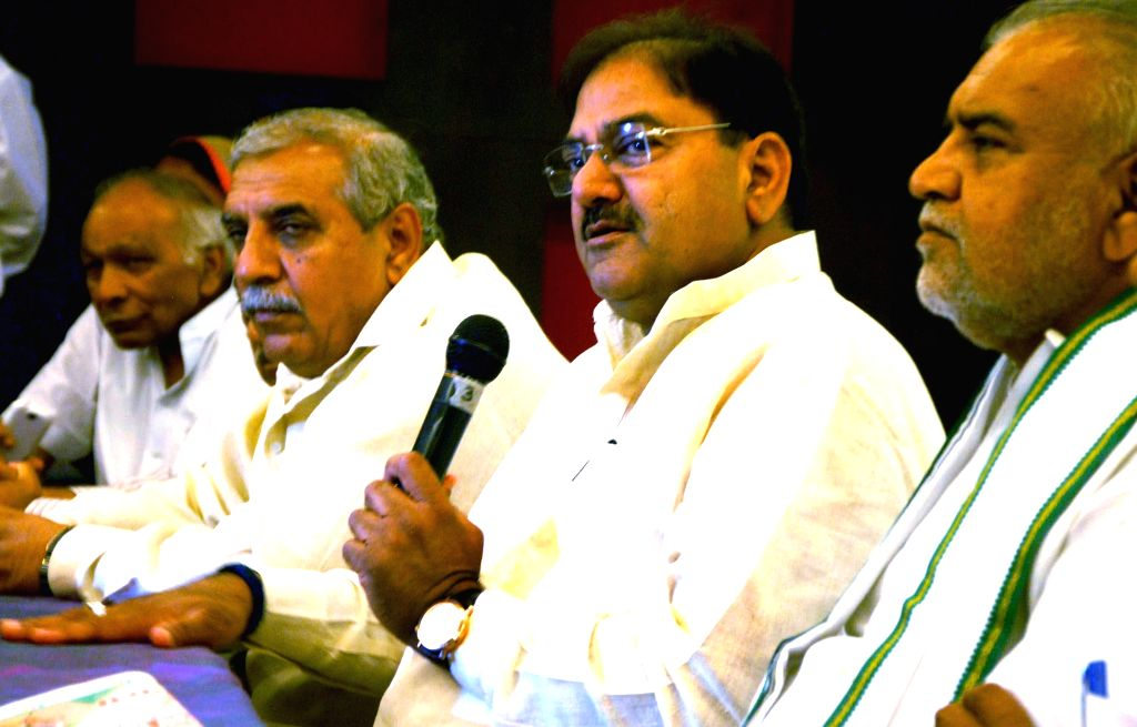 NLD leader Abhay Chautala and others announce list of candidates contesting upcoming Haryana assembly polls in Gurgaon on Aug 21, 2014. (Photo: IANS)