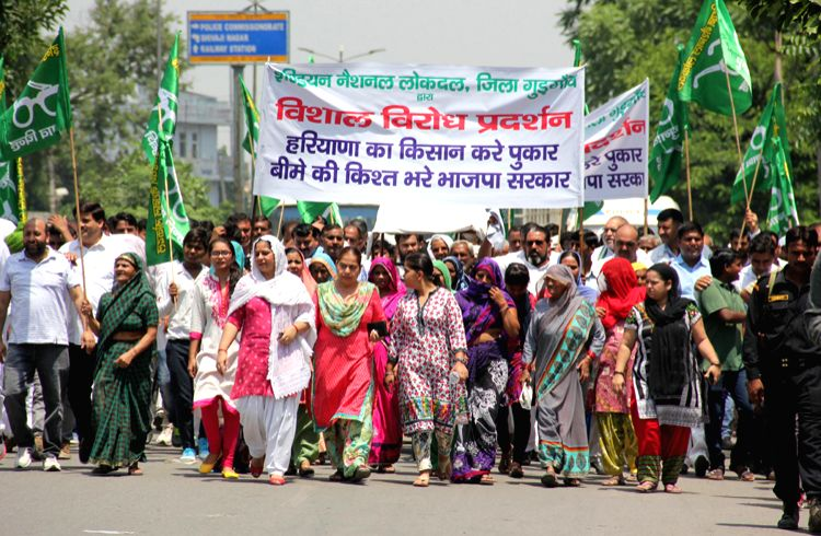 NLD protest against crop insurance scheme