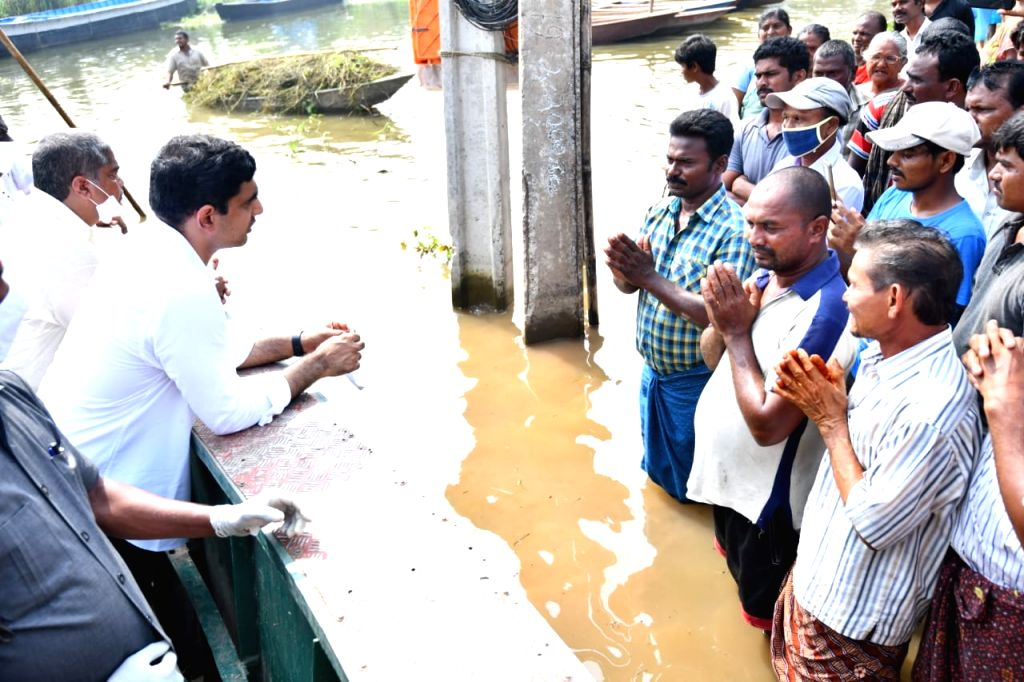 No minister visiting floods-stricken people in AP: Lokesh Attachments area