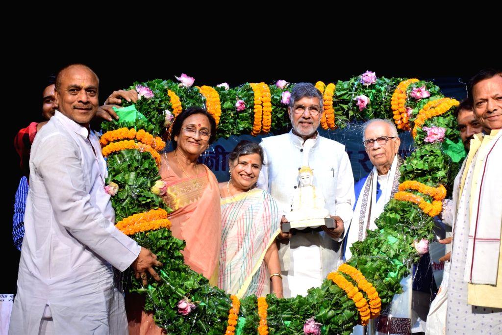 Nobel Laureate Kailash Satyarthi being felicitated by Justice (retired) Arun Tandon and BJP MP Rita Bahuguna Joshi during a programme in Kolkata on Sep 4, 2019. - Kailash Satyarthi and Rita Bahuguna Joshi