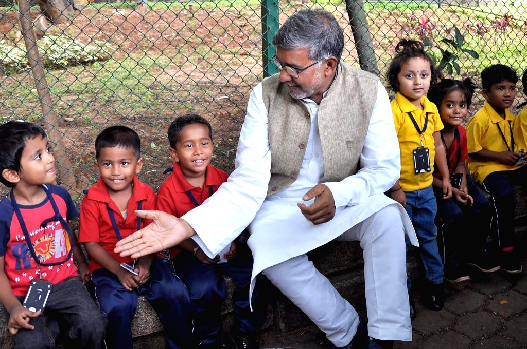 Nobel laureate Kailash Satyarthi interacting with children at Bal Bhavan during the launch of Leher, an all India competition to make 52 one minute films against Child Sex Abuse in ... - Kailash Satyarthi