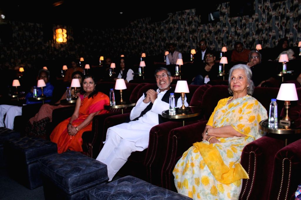 "Nobel Peace Laureate Kailash Satyarthi and actress Waheeda Rehman at the screening of filmmaker Rakeysh Omprakash Mehra's documentary ""The Price of Free"" that is based on a true ... - Waheeda Rehman and Kailash Satyarthi"