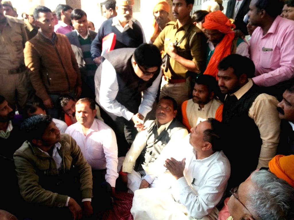 Noida: BJP Legislator Rakesh Singh Baghel,stages a sit-in demanding action against district and police officials, who lathicharged his supporters, in Noida on March 7, 2019. He was roughed up by Bharatiya Janata Party (BJP) MP from Sant Kabir Nagar S - Ashutosh Tandon and Rakesh Singh Baghel
