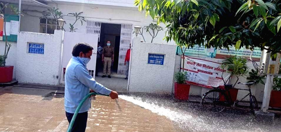 Noida: Gautam Buddha Nagar District Magistrate's Office being sanitised, in Noida on March 21, 2020. (Photo: IANS)