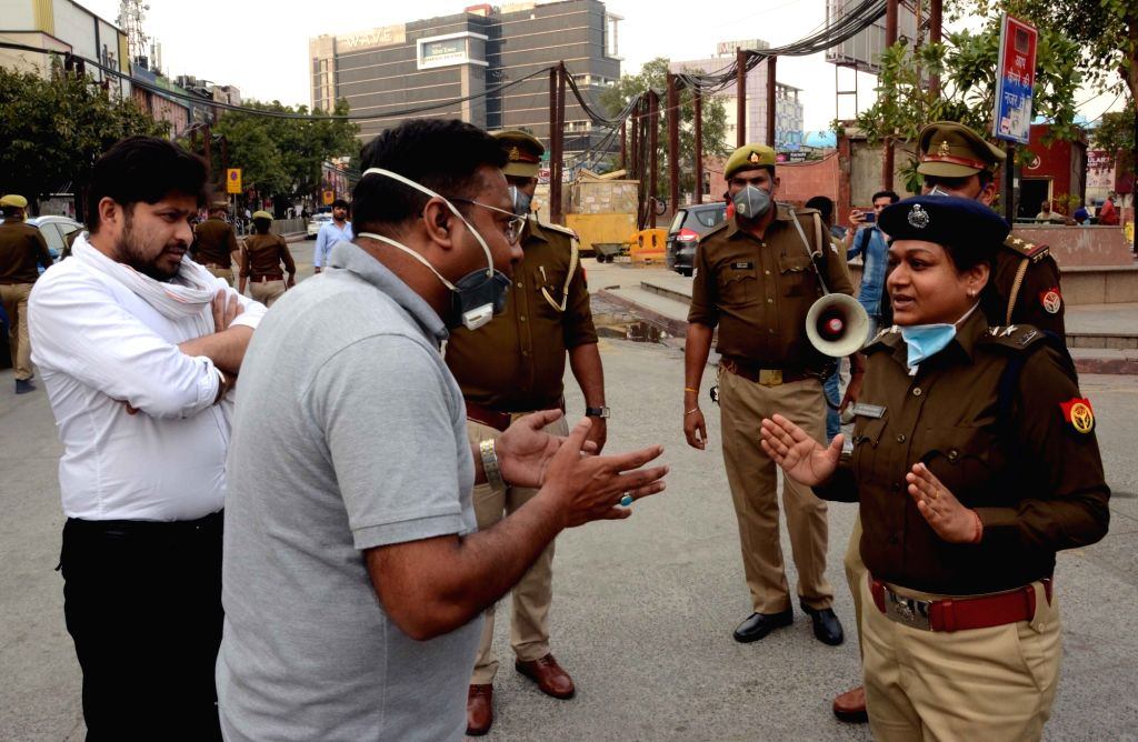 Noida Joint Police Commissioner Meenakshi Katyayan interacts with people during an awareness drive being conducted by the police to alert people on measures they should take to contain the ...