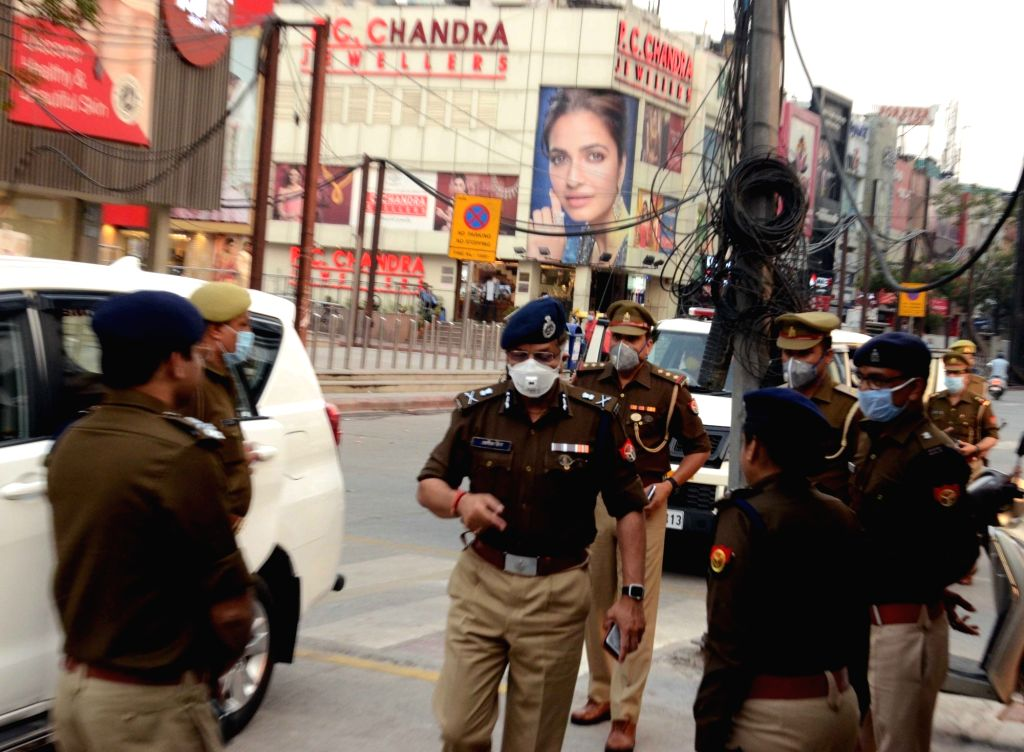 Noida Police Commissioner Alok Singh arrives to preside over a meeting regarding COVID-19 ahead of Sunday's nationwide 'Janata Curfew' imposed in the wake increasing cases of Coronavirus, in Noida ...