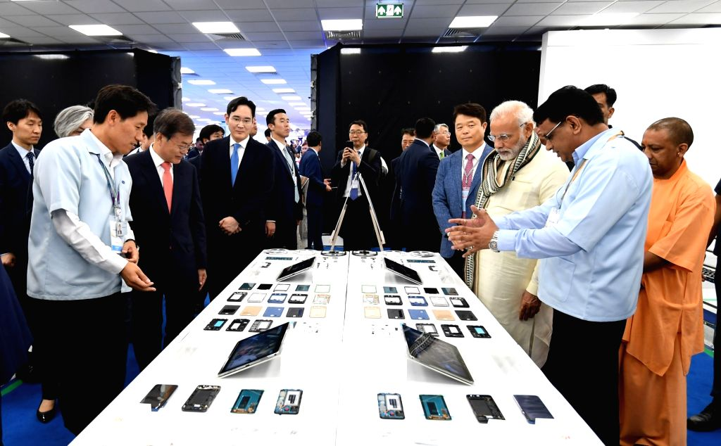 Noida: Prime Minister Narendra Modi and South Korea President Moon Jae-in take a tour of World's Largest Mobile Factory in Noida on July 9, 2018. (Photo: IANS/PIB) - Narendra Modi
